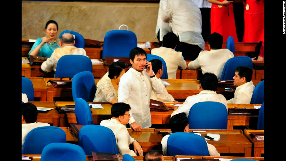 "Pacquiao attends a session of the Lower House as congressman representing his home district of Sarangani during the State of The Nation address of President Benigno ""NoyNoy"" Aquino on July 26, 2010."