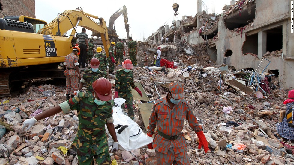 Members of the Bangladeshi army and firefighters carry the body of a garment worker from the scene of the building collapse in Savar, outside Dhaka, on Sunday, May 5.
