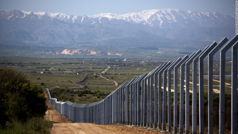 "A fence between Syria and Israel, pictured on April 24, <a href=""http://www.cnn.com/2013/01/07/world/meast/syria-civil-war"">was recently built by the Israelis</a> to prevent violence spilling over from the Syrian conflict."