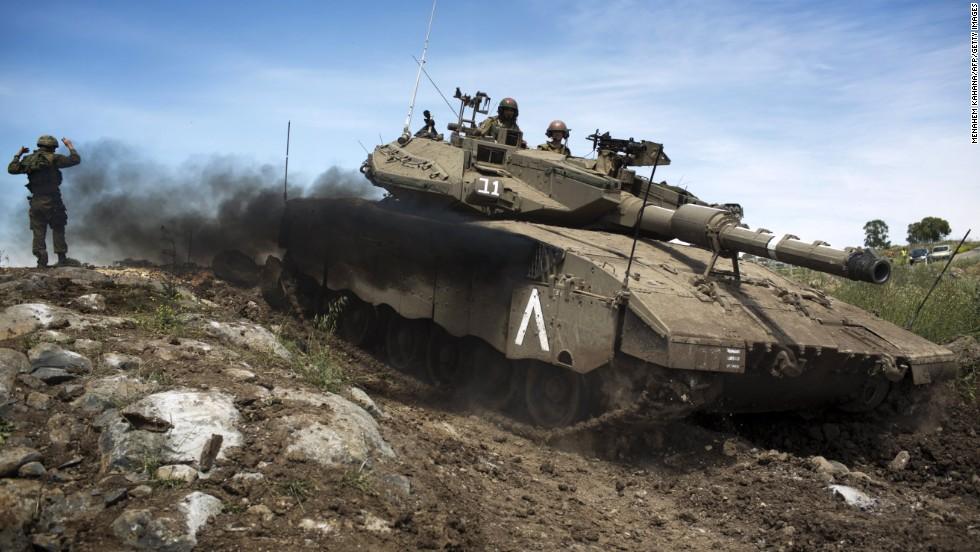 An Israeli Merkava tank maneuvers during a drill in the Golan Heights on April 24.
