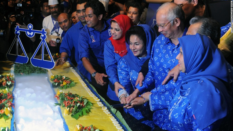 "MAY 06 - KUALA LUMPUR, MALAYSIA: Prime Minister Najib Razak and his wife Rosmah Mansor cut a cake to celebrate the <a href=""http://cnn.com/2013/05/02/world/asia/malaysia-election-preview/index.html?hpt=ias_c1"">Barisan Nasional (National Front) coalition victory</a>, which has ruled for 56 years. Vote-rigging allegations and violence marred the most hotly contested election in Malaysian history."