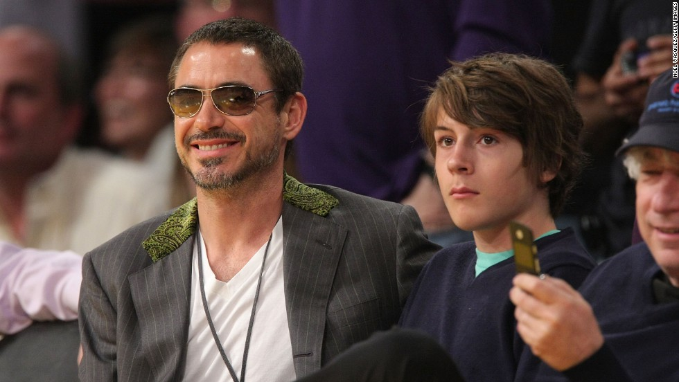 Downey and his son Indio attend a Los Angeles Lakers playoff game in 2008.