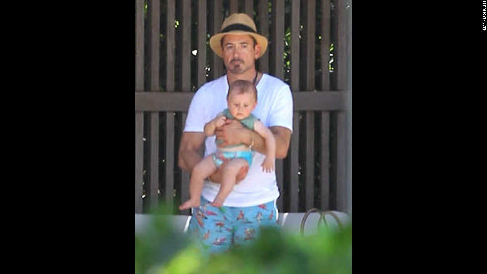 """In 2012, Downey and wife Susan became parents of a son, Exton. The 48-year-old's resilience, charm and talent have earned him a high-ranking spot in the box office with """"Iron Man 3,"""" which had the second-best opening weekend, behind """"The Avengers' """" $207.4 million bow on this weekend a year ago. """"The Daily Show's"""" Jon Stewart had a straight face when he told the actor """"You are Iron Man. You are."""""""
