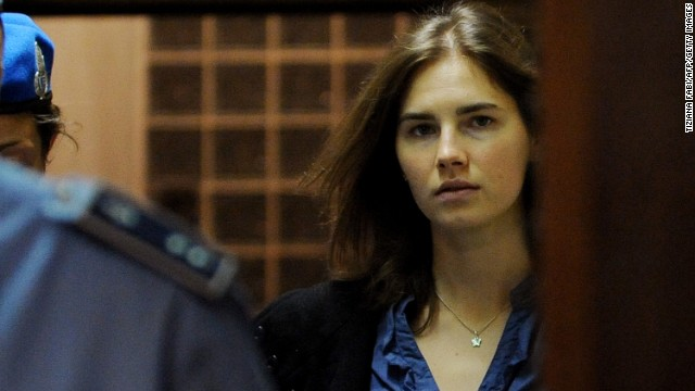 Amanda Knox (R), US national accused of the 2007 murder of her housemate Meredith Kercher arrives at the court during the resumption of her appeal trial in Perugia on September 30, 2011.