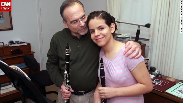 13-year-old Mano Kolman and her father Barry prepare to play a clarinet duet together.