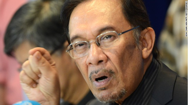 Opposition leader Anwar Ibrahim answers a question during a press conference at his party head office on May 7, 2013.