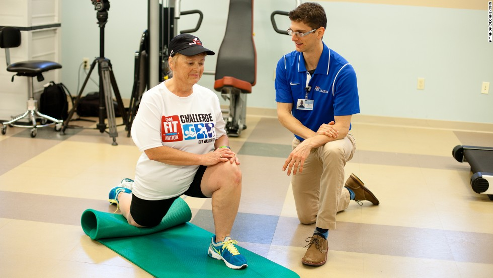 Timme stretches her hip flexor at the National Training Center.