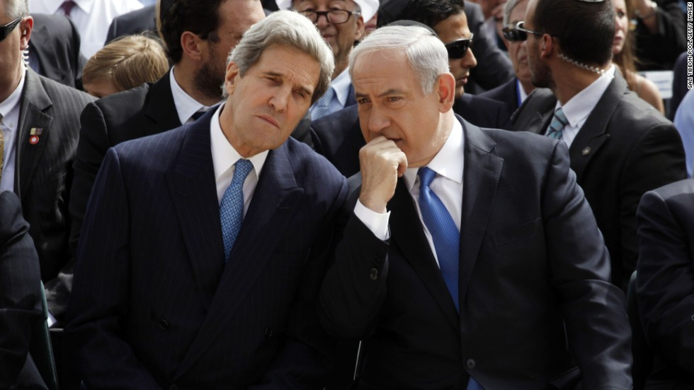 Israeli Prime Minister Benjamin Netanyahu, right, speaks with U.S. Secretary of State John Kerry during the annual ceremony for the Holocaust Remembrance day at the Yad Vashem memorial on April 8, 2013, in Jerusalem.