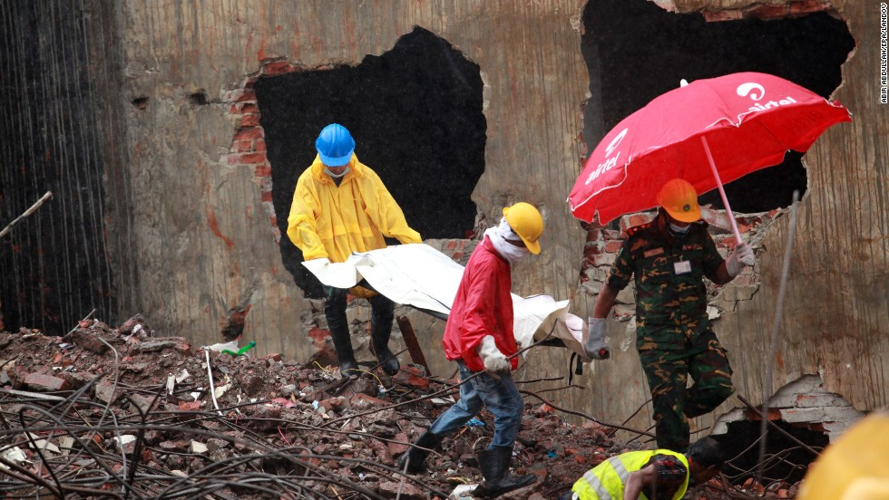 Rescue workers recover a body from the rubble on May 7.
