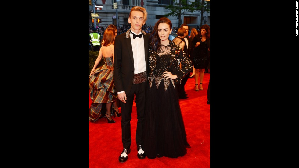 Jamie Campbell Bower and Lily Collins attend the gala.