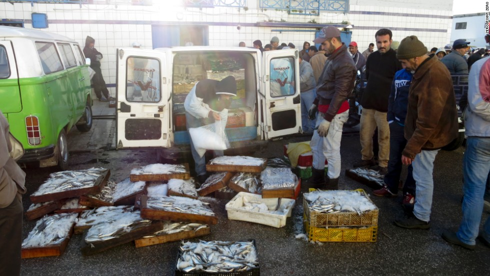 Fishermen work at the fish market at the port of Tangier.