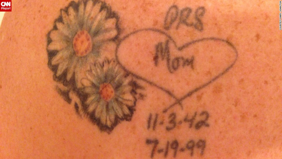 """Mary Johnston and her brother have <a href=""""http://ireport.cnn.com/docs/DOC-968765"""">matching tattoos</a> in their mother's handwriting. The """"Mom"""" signature and heart were taken from a birthday card. """"We both had the tattoo placed on our left shoulder blade because Mom always had our backs,"""" said Johnston. She later added the two daises, """"one for mom and one for me. We each carried them in our bridal bouquets."""""""