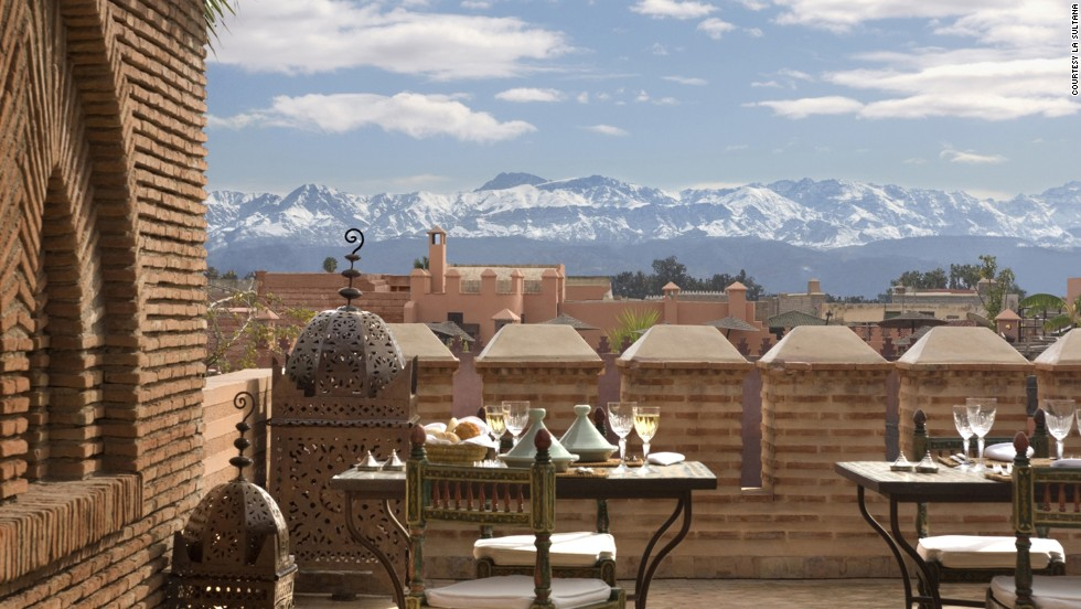 The traditional Moroccan house (riad) comes with the perfect sunset terrace, which often serves as a place to hang the laundry. Visitors will find views of the Atlas Mountains from atop the luxurious digs at La Sultana in Marrakech.