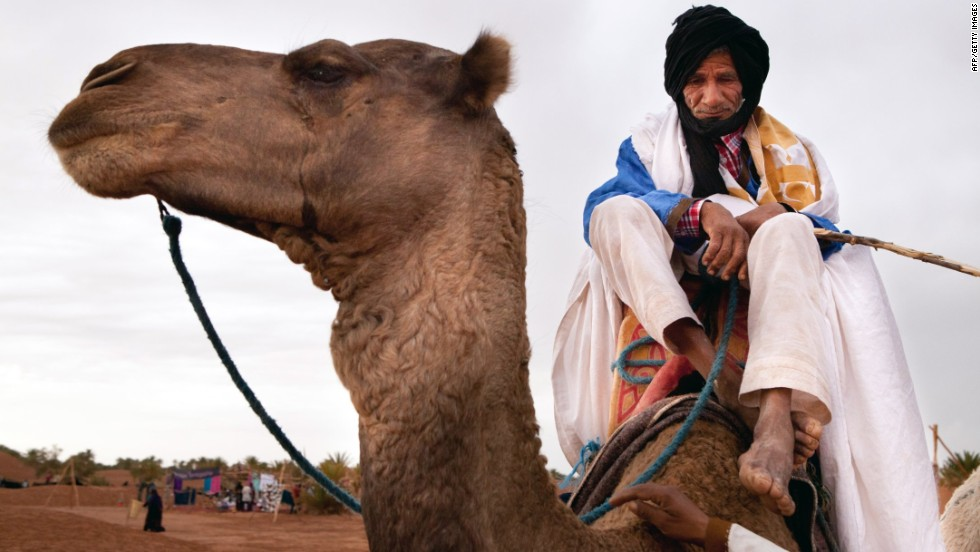 A nomad rides a camel during the Taragalte Music Festival in Mhamid El-Ghizlane near Zagora on November 9.
