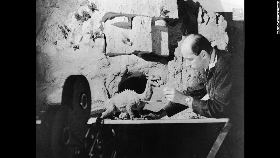 Harryhausen works with a figure of a dinosaur for an unidentified film.