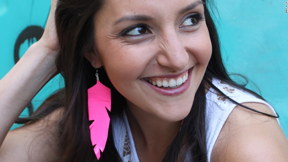 "Morin models <a href=""http://www.brit.co/flirty-fluorescent-feathers-another-win-for-duct-tape/"" target=""_blank"">fluorescent feather earrings</a> made with neon duct tape."
