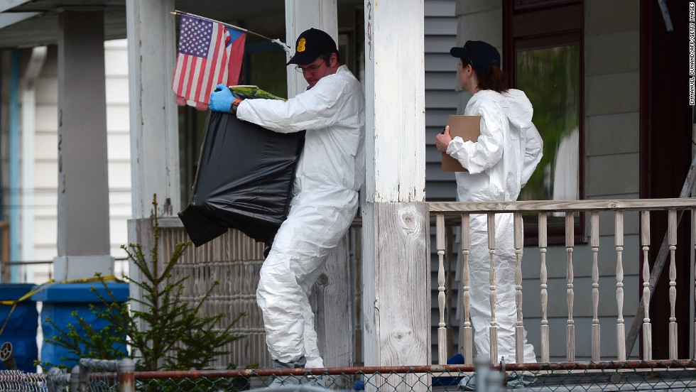 Investigators remove evidence from the house on Seymour Avenue in Cleveland where the three women were held.