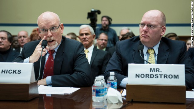 Eric Nordstrom, Diplomatic Security Officer and former US State Department Regional Security Officer in Libya, listens while Gregory Hicks, Foreign Service Officer and former Deputy Chief of Mission/Charge d?Affairs in Libya, speaks during a hearing of the House Committee On Oversight and Government Reform on Capitol Hill May 8, 2013 in Washington, DC. The committee held the hearing to investigate the events and response to a 2012 attack on one of the United States's diplomatic compounds in Benghazi, Libya. AFP PHOTO/Brendan SMIALOWSKI        (Photo credit should read BRENDAN SMIALOWSKI/AFP/Getty Images)