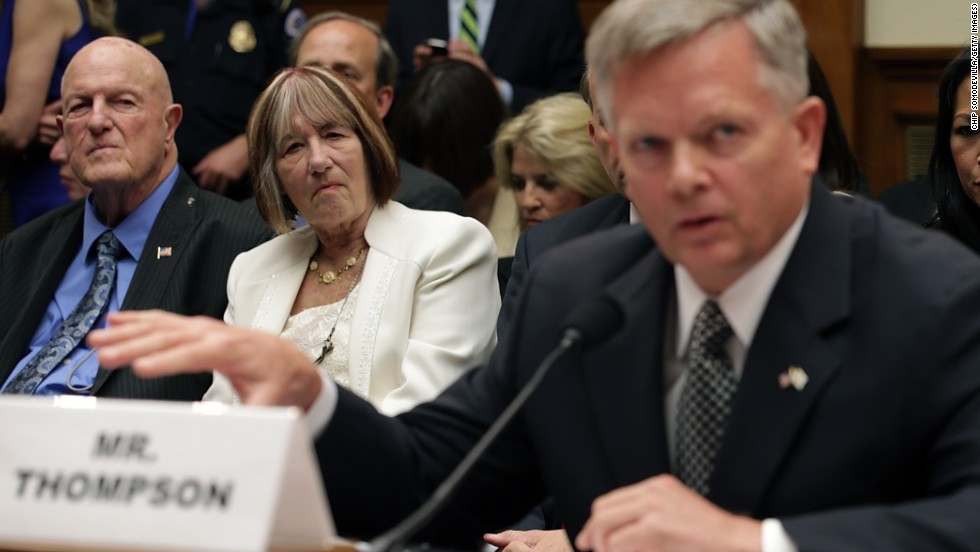 Ray Smith, left, and Pat Smith listen as Thompson testifies. Their son Sean was one of the four Americans killed in the terror attack.