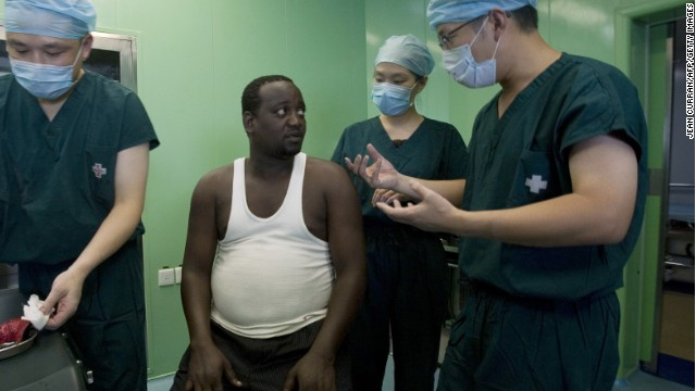 A Chinese surgical team speaks with a Kenyan patient who was treated on a Chinese hospital ship during a 2010 goodwill tour.