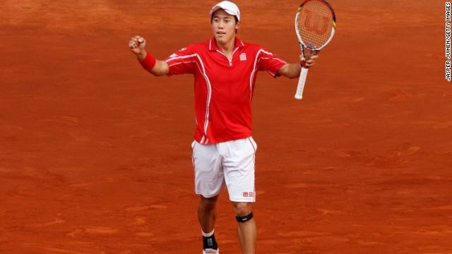 Kei Nishikori celebrates his victory over 17-time grand slam winner Roger Federer at the Madrid Masters.