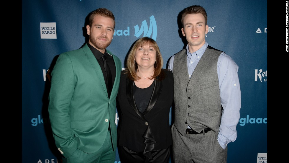 Scott Evans, left, and Chris Evans with their mother, Lisa Evans.