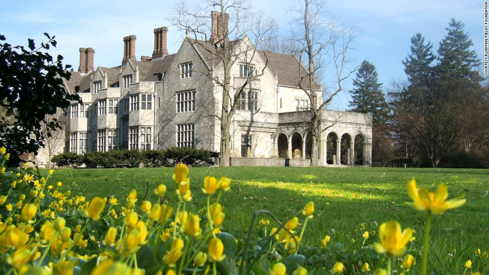 "<a href=""http://www.plantingfields.org"" target=""_blank"">Coe Hall</a>, a 65-room Elizabethan-style mansion, was built from 1918-1921 by Walker & Gilette for William Robertson Coe. Coe was a marine insurance executive and his wife, Mai Coe, was the daughter of Henry Huttleston Rogers, one of the founders of Standard Oil. The house, furnished with antiques and artwork, is open for self-guided tours."