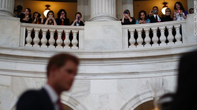 Capitol Hill staff take pictures of Prince Harry from the balcony of the Russell Senate Office Building on May 9.