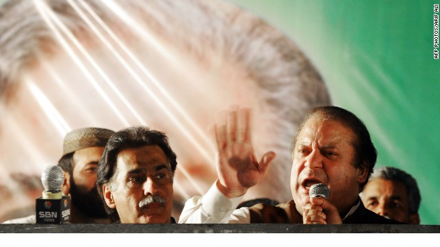 Former Pakistani Prime Minister Nawaz Sharif, right, speaks at a campaign closing rally in Lahore on May 9.