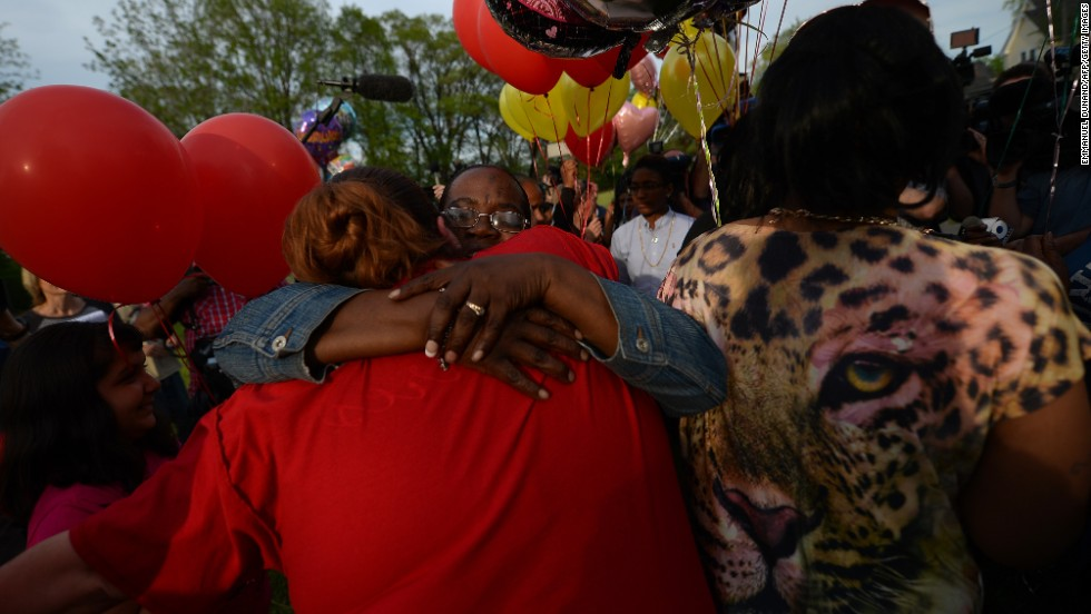 "Residents gather outside a community meeting at Immanuel Lutheran Church on Thursday, May 9, to talk about <a href=""http://www.cnn.com/2013/05/09/us/ohio-missing-women-found/index.html?hpt=hp_t1"">the kidnapping case in Cleveland</a>. Balloons were released as part of the ceremony."