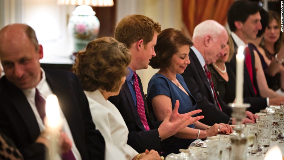 For dinner, Harry sits between Teresa Heinz, left, wife of Secretary of State John Kerry, and Lady Westmacott, the wife of the British ambassador.