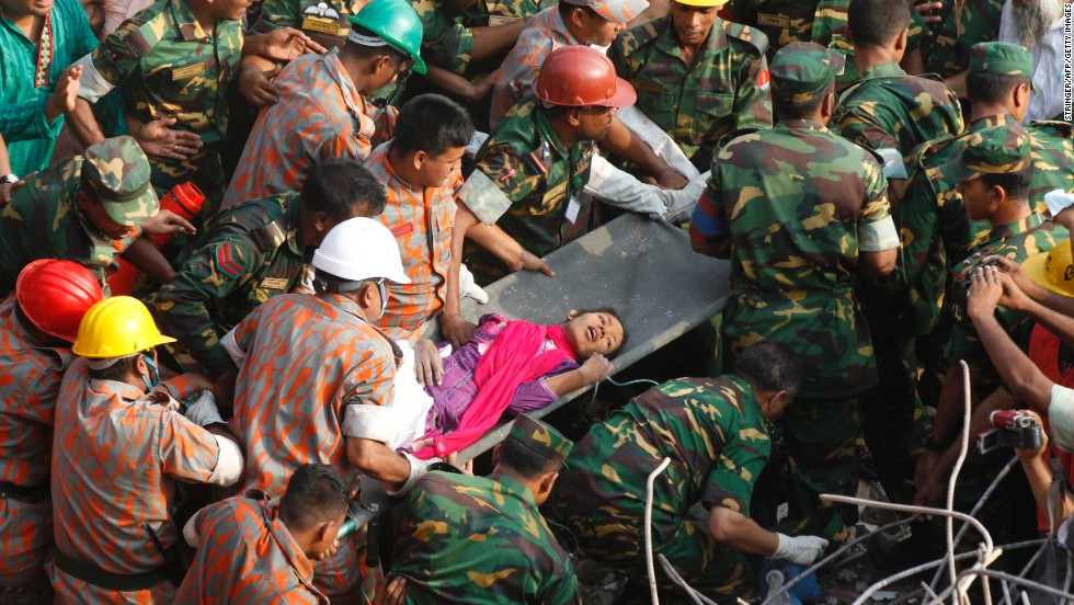 "Rescue workers carry <a href=""http://www.cnn.com/2013/05/13/world/asia/bangladesh-building-collapse/index.html"">Reshma Begum</a>, 19, to safety on Friday, May 10, a day after her discovery alive amid the wreckage of a building that had entombed her since it collapsed on April 24, in Dhaka, Bangladesh. At least 1,127 people have been confirmed dead from the <a href=""http://www.cnn.com/2013/05/12/world/asia/bangladesh-building-collapse/index.html"">garment factory building collapse</a>."