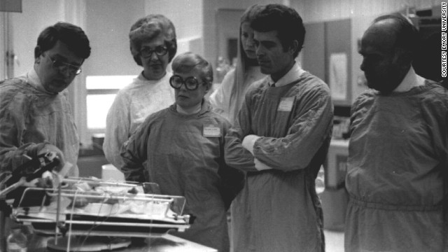 Brann, far left, talks to his colleagues at Grady Memorial Hospital in Atlanta in an undated photo.