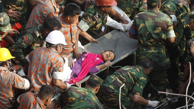 Bangladeshi rescuers retrieve garment worker Reshma from the rubble of a collapsed building in Savar on May 10, 2013, seventeen days after the eight-storey building collapsed. The death toll from last month's collapse of a garment factory complex in Bangladesh rose past 1,000 as piles of bodies were found in the ruins of a stairwell where victims had sought shelter.