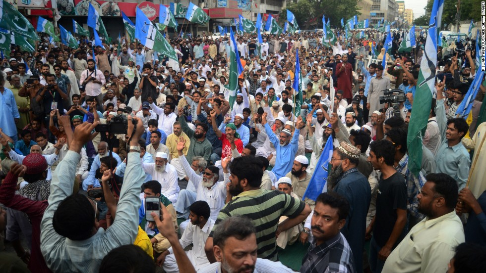 Pakistani supporters of Islamic party Jammat-e-Islami stage a protest in front of a provincial election commission office in Karachi on May 11.