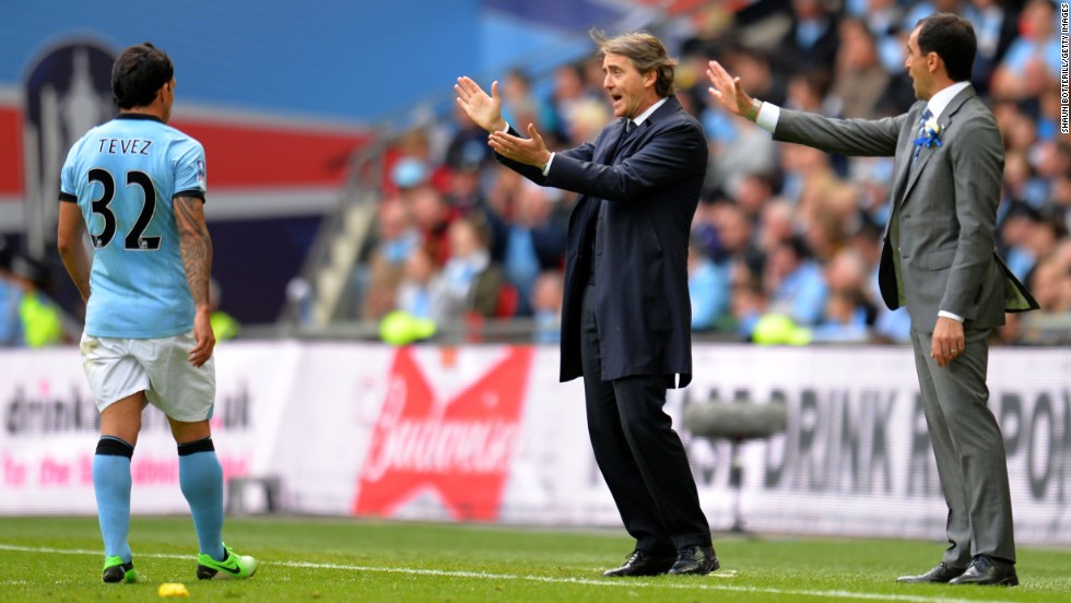 Speculation has been rife that the clubs' respective managers will be elsewhere next season. Reports claim City's Roberto Mancini, center, will be replaced by Malaga's Manuel Pellegrini, while Martinez has been linked with a move to Everton.