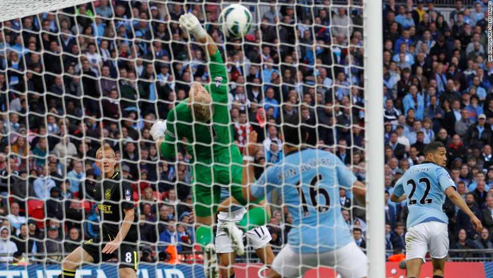 Wigan's winner came in time added on from substitute midfielder Ben Watson, left, who headed past City's England goalkeeper Joe Hart. Watson missed almost six months this season with a broken leg.