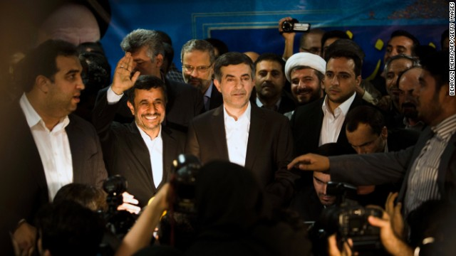 Iranian President Mahmoud Ahmadinejad accompanies Esfandiar Rahim Mashaie, center,  to register his candidacy.