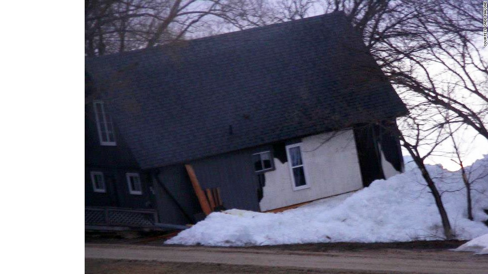 This house, pictured on May 12, was knocked off its foundation.