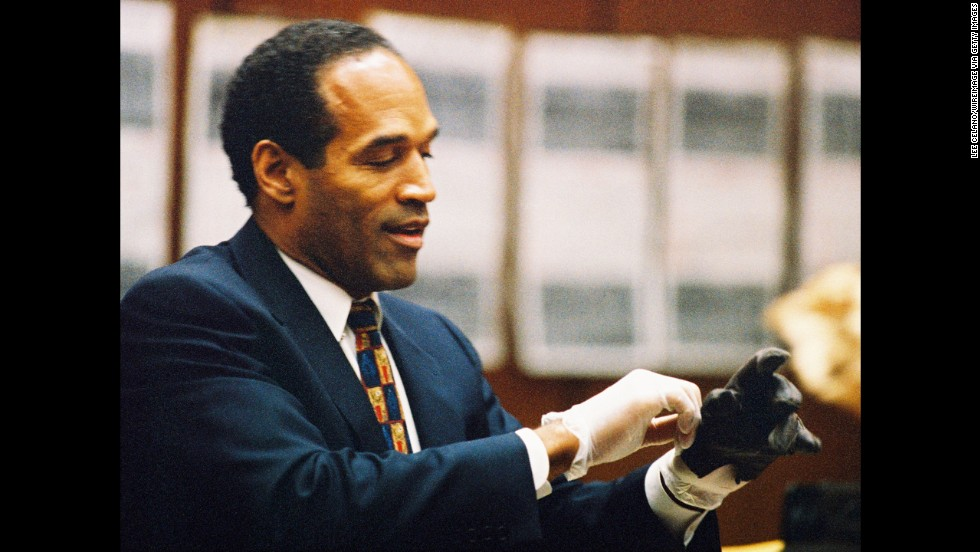 "<a href=""http://www.cnn.com/US/OJ/daily/9-27/8pm/"">""If it doesn't fit, you must acquit"" </a>was defense attorney Cochran's mantra during the trial. Here, Simpson tries on a leather glove tied to the crime scene at his murder trial on June 15, 1995."