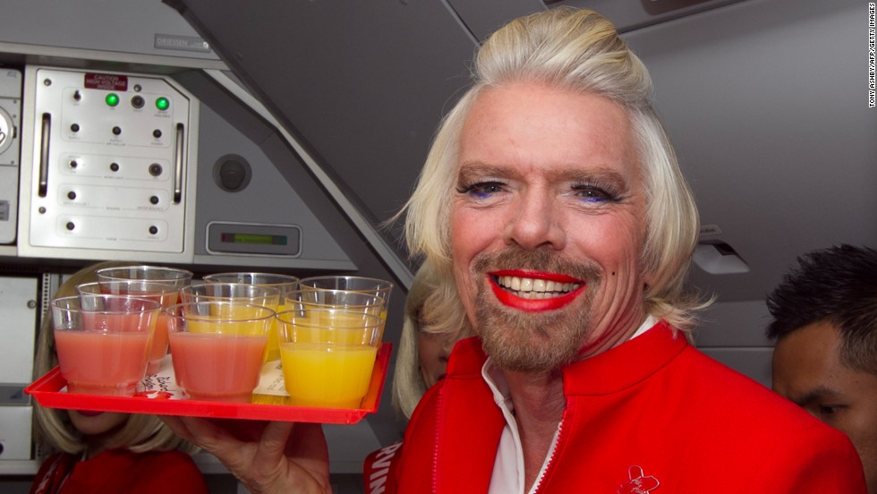 Sir Richard Branson worked as an AirAsia X flight attendant on Sunday after losing a bet to AirAsia CEO Tony Fernandes.
