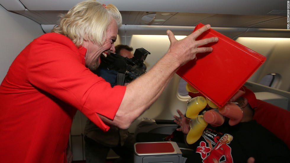 "Branson is probably the only flight attendant who can get away with ""spilling"" drinks on the airline boss and laughing about it."
