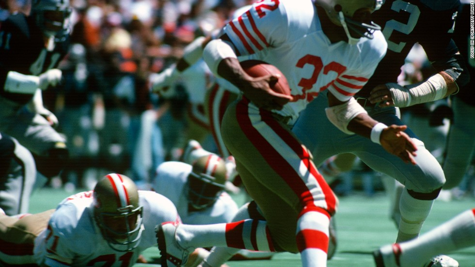As a running back for the San Francisco 49ers, Simpson carries the ball against the Oakland Raiders during a preseason game circa 1978.
