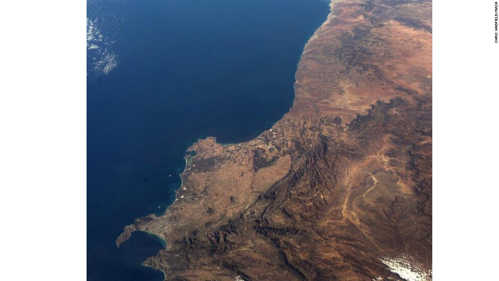 """This photo shows """"the <a href=""""https://twitter.com/Cmdr_Hadfield/status/333846272823947264/"""" target=""""_blank"""">southwest corner of Africa</a>, from space."""""""