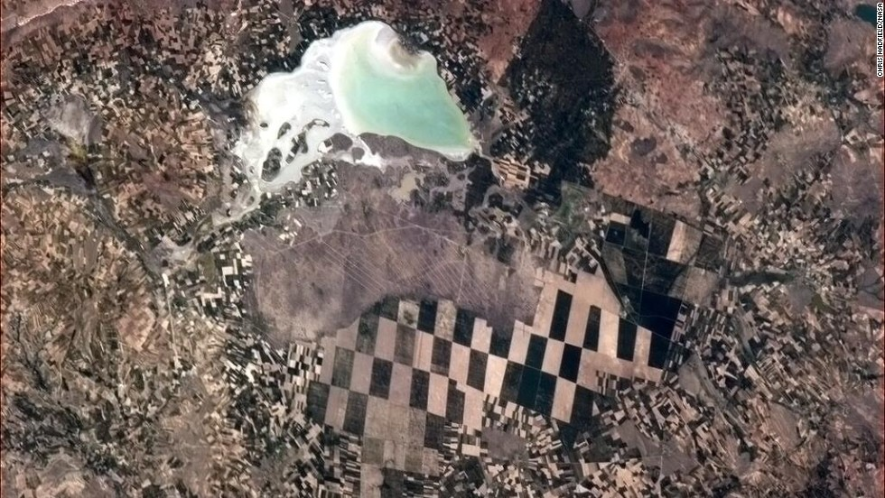 """A <a href=""""https://twitter.com/Cmdr_Hadfield/status/332215204224057344"""" target=""""_blank"""">checkerboard scene</a> below. """"Little farmers, big farmers and nature, in Turkey,"""" Hadfield wrote on May 8."""