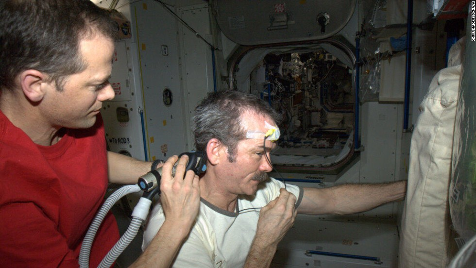 "Hadley got a <a href=""https://twitter.com/Cmdr_Hadfield/status/320960647728873473"" target=""_blank"">space haircut</a> as depicted in this April 7 photo. ""Dr. Tom doing a nice, surgical job of trimming, working around the science experiment (temperature) sensor,"" Hadfield tweeted."