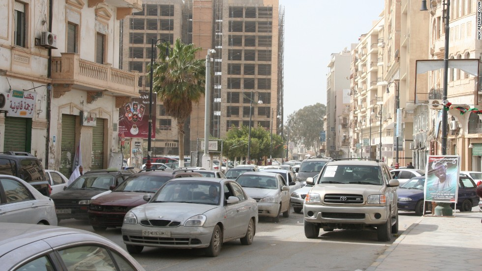 Car rental companies are building a presence in Libya, but finding someone else to do the hard work of fighting traffic, sandstorms and camels will make for a more relaxing trip.