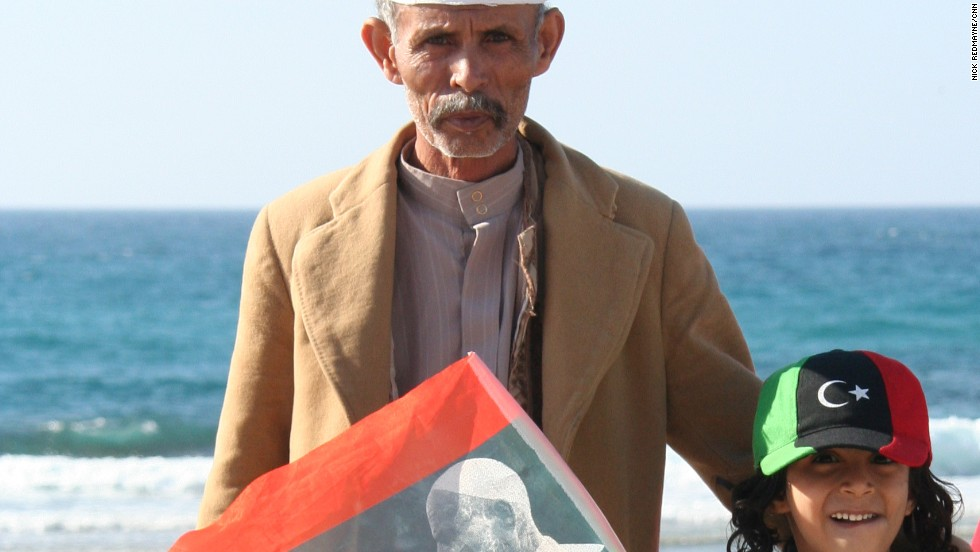 Gaddafi imagery has been replaced by that of an elderly man in white robes -- Omar Mukhtar, seen here on a flag. Mukhtar was a nationalist hero whose fighters resisted Italian colonialists in Libya for nearly 20 years.