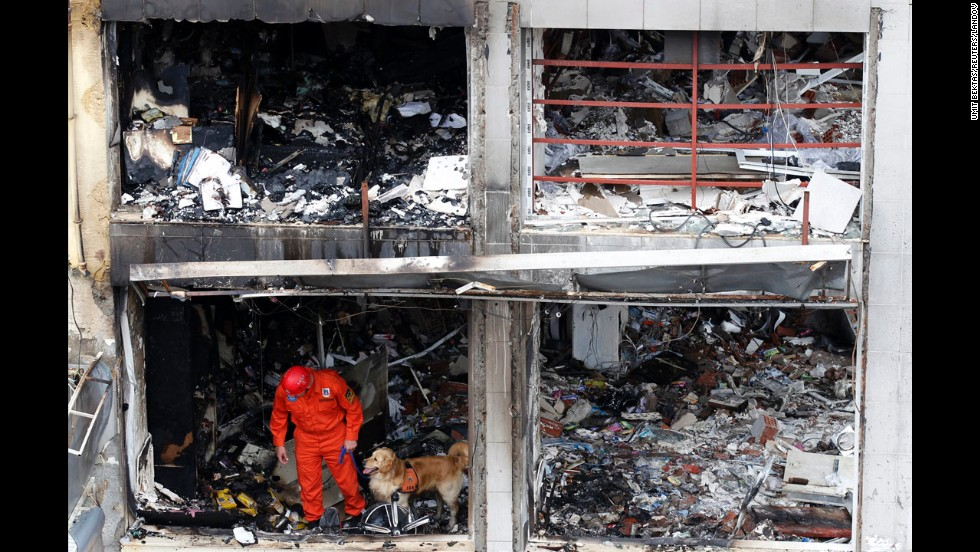 A search and rescue team member and his dog work on one of the bombing sites near Reyhanli's shopping district on May 12.