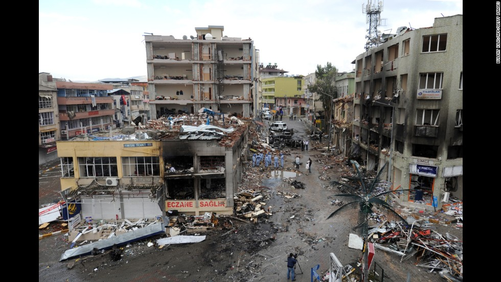 Police investigate the Reyhanli neighborhood on May 12 where buildings collapsed, glass shattered and fire scorched the street and injured bystanders after the bombings the day before.